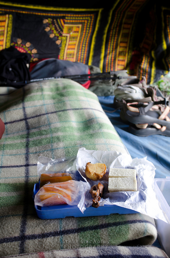 Trekkers box lunch in Kashmiri tent, Western Himalayan Mountains, Kashmir, India..