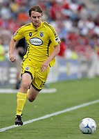 Columbus Crew mdifielder Eddie Gavin (12) cuts toward the Chicago Fire goal.  The Chicago Fire tied the Columbus Crew 0-0 at Toyota Park in Bridgeview, IL on July 11, 2009.