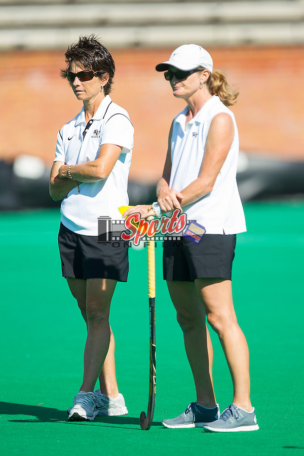 (L-R) Wake Forest Demon Deacons head coach Jennifer Averill and assistant coach Christy Morgan watch their team go through pre-game drills prior to taking on the Liberty Flames at Kentner Stadium on September 13, 2013 in Winston-Salem, North Carolina.  The Demon Deacons defeated the Flames 3-2.  (Brian Westerholt/Sports On Film)