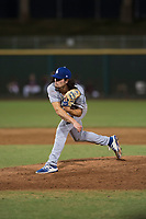 AZL Dodgers relief pitcher Riley Ottesen (11) follows through on his delivery during an Arizona League game against the AZL Indians 2 at Goodyear Ballpark on July 12, 2018 in Goodyear, Arizona. The AZL Indians 2 defeated the AZL Dodgers 2-1. (Zachary Lucy/Four Seam Images)