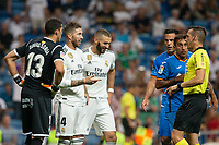 Karim Benzema and Sergio Ramos of Real Madrid during the match between Real Madrid v Getafe CF of LaLiga, 2018-2019 season, date 1. Santiago Bernabeu Stadium. Madrid, Spain - 19 August 2018. Mandatory credit: Ana Marcos / PRESSINPHOTO