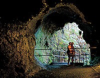 Couple standing at the exit of Thurston Lava Tube at Hawai'i Volcanoes National Park, Big Island.