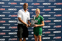 8 November 2015:  Marshall Forward Erin Simmons (32) is presented an award after the match as the University of North Texas Mean Green defeated the Marshall University Thundering Herd, 1-0, in the Conference USA championship game at University Park Stadium in Miami, Florida.