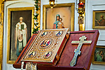 Close up of historical bible and cross at Holy Transfiguration of Our Lord Chapel, Ninilchik, Kenai Peninsula, Southcentral Alaska.