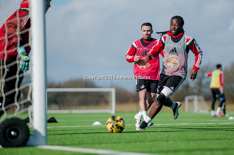 SWANSEA, WALES - FEBRUARY 17:  Leon Britton and Marvin Emnes of Swansea City   in action during a training session at the Fairwood training ground on February 17, 2015 in Swansea, Wales.  (Photo by Athena Pictures )