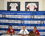 """9 September 2008: US Men's soccer head coach Bob Bradley (USA) (center) and players Carlos Bocanegra (USA) (left) and Landon Donovan (USA) (right). US Soccer held a press conference in preparation for their semifinal round World Cup Qualifying match against Trinidad and Tobago.  The press conference was held at """"Soccer House"""", the US Soccer offices in Chicago, Illinois."""