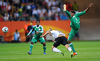 Alexandra Popp (r) of team Germany and Osinachi Ohale of team Nigeria during the FIFA Women's World Cup at the FIFA Stadium in Frankfurt, Germany on June 30th, 2011.
