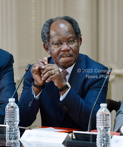 Bayo Ogunlesi, Chairman, Global Infrastructure Partners listens as United States President Donald Trump speaks during a strategic and policy discussion with CEOs in the State Department Library in the Eisenhower Executive Office Building (EEOB) in Washington, DC, April 11, 2017.<br /> Credit: Olivier Douliery / Pool via CNP