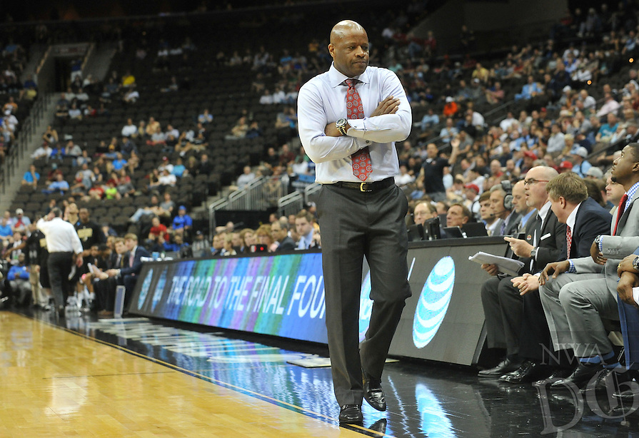 NWA Democrat-Gazette/Michael Woods --03/19/2015--w@NWAMICHAELW... University of Arkansas coach Mike Anderson walks along the sideline in the second half of Thursday nights 56-53 win against the Wofford Terriers in the 2015 NCAA basketball tournament at Jacksonville Veterans Memorial Arena in Jacksonville, Florida.