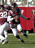 Nov 27, 2010; Charlottesville, VA, USA; Virginia Tech Hokies quarterback Tyrod Taylor (5) runs the ball during the game against the Virginia Cavaliers at Lane Stadium. Virginia Tech won 37-7. Mandatory Credit: Andrew Shurtleff-