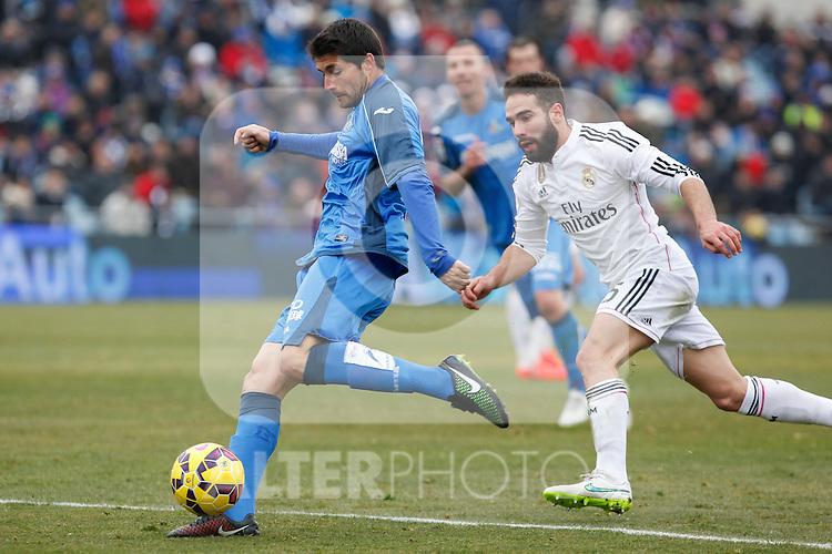 Getafe´s Alex Felip (L) and Real Madrid´s Daniel Carvajal during La Liga match at Coliseum Alfonso Perez stadium  in Getafe, Spain. January 18, 2015. (ALTERPHOTOS/Victor Blanco)