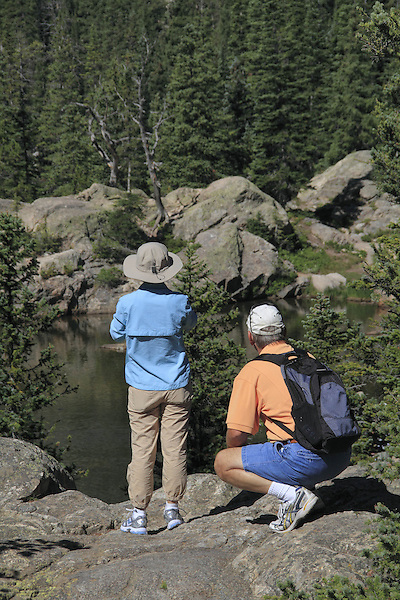 Couple looking at Dream Lake, Rocky Mountain National Park, west of Estes Park, Colorado, USA