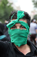A man in Toopkhaneh Square wearing green, the colour of the opposition, and a mask as a symbol of his silent protest. Following a disputed election result, thousands of supporters of opposition candidate Mir-Hossein Mousavi took to the streets in protest.