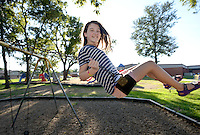 NWA Democrat-Gazette/BEN GOFF @NWABENGOFF<br /> Emily Meythaler, 12, swings on Thursday Aug. 20, 2015 at the playground at Sugar Creek Elementary in Bentonville.