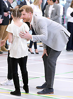 11 April 2019 - Prince Harry, Duke of Sussex speaks with a young member who takes part in activities during the official opening of the Barking & Dagenham Future Youth Zone in Dagenham, England.  The facility is created by the Charity OnSide Youth Zones and is the first of three facilities expected to open in 2019, which will provide a safe environment where young people can come and enjoy themselves, build key skills and raise their aspirations and confidence to create a happier and healthier generation. Photo Credit: ALPR/AdMedia