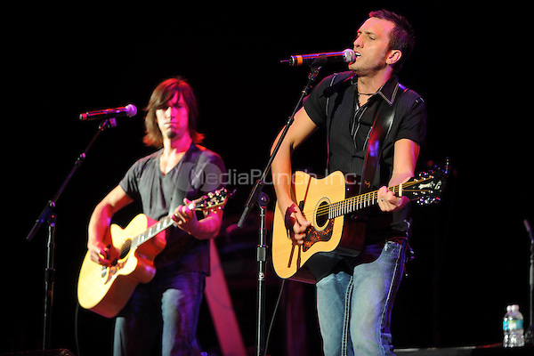 WEST PALM BEACH, FL - OCTOBER 11 : (L-R) Brad and Brett Warren of the Country duo Warren Brothers perform at the Cruzan Ampitheatre on October 11, 2008 in West Palm Beach Florida.  Credit: mpi04/MediaPunch