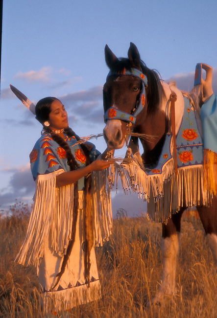 Northern Shoshone tribal member Randy'l Hedow Teton is dressed in a brain tanned dress that was made by her grandmother Juanita Teton along with the horse tack of a beaded bridle, breast collar and traditional Indian saddle all matching with the Shoshone rose emblem