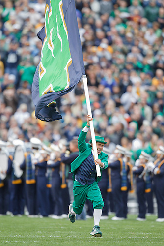 The Notre Dame leprechan leads the team onto the field during NCAA football game between Stanford and Notre Dame.  The Stanford Cardinal defeated the Notre Dame Fighting Irish 37-14 in game at Notre Dame Stadium in South Bend, Indiana.