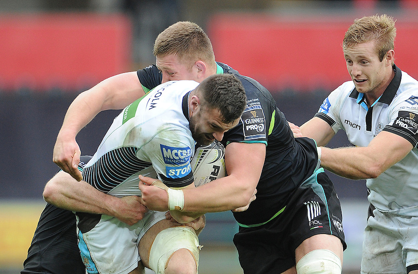 Glasgow Warriors' Rory Hughes is tackled by Ospreys' Brendon Leonard and Lloyd Ashley<br /> <br /> Photographer Ian Cook/CameraSport<br /> <br /> Guinness PRO12 Round 16  - Ospreys v Glasgow Warriors - Sunday 26th February 2017 - Liberty Stadium - Swansea<br /> <br /> World Copyright &copy; 2017 CameraSport. All rights reserved. 43 Linden Ave. Countesthorpe. Leicester. England. LE8 5PG - Tel: +44 (0) 116 277 4147 - admin@camerasport.com - www.camerasport.com