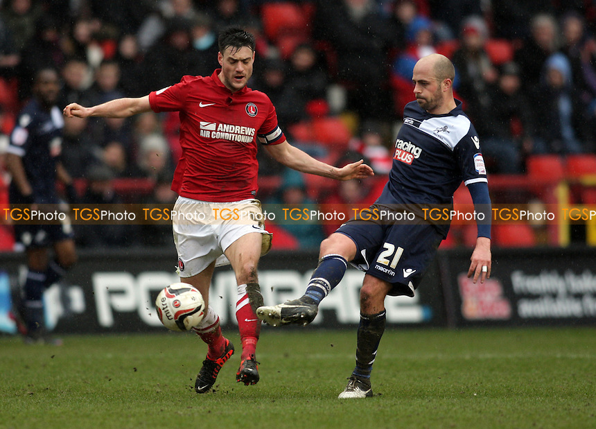 Jack Smith of Millwall FC passes the ball under pressure from Johnnie Jackson of Charlton Athletic - Charlton Athletic vs Millwall - NPower Championship Football at the Valley, London - 16/03/13 - MANDATORY CREDIT: Helen Watson/TGSPHOTO - Self billing applies where appropriate - 0845 094 6026 - contact@tgsphoto.co.uk - NO UNPAID USE.