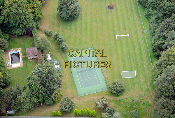 ATMOSPHERE .Aerial view of Cheryl & Ashley Cole's mansion, Hurtmore, Surrey, England. September 16th, 2009 .gv g.v. general view tweedy house home property trees land grass five-a-side football pitch tennis court sport.CAP/FIN.©Steve Finn/Capital Pictures.