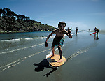 Skim boarding at Big River Beach near Mendocino, California