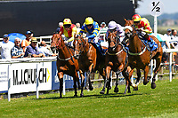 Winner of The Inspire Foundation Veterans' Handicap   Rio Ronaldo (r) ridden by Adrea Atzeni and trained by Mike Murphy during Whitsbury Manor Stud Bibury Cup Day Racing at Salisbury Racecourse on 27th June 2018