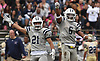 Alijah James #6 of Oceanside, right, and Christian Muller #21 after teammate Connor Calkin #56 (not in picture) recovered a Baldwin fumble in the second quarter of a Nassau County Conference I varsity football game played at Baldwin High School on Saturday, Oct. 6, 2018. Oceanside won by a score of 35-0.