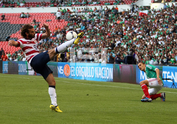 MEXICO CITY, MEXICO - AUGUST 15, 2012:  Kyle Beckerman (5) of the USA MNT boots the ball up field during an international friendly match at Azteca Stadium, in Mexico City, Mexico on August 15. USA won 1-0.