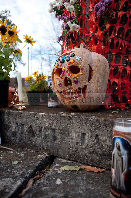 A decorated pumpkin decorates a gravestone at the Day of the Dead Ceremony in Downtown  Lexington, Ky., on Thursday, November 1, 2012..