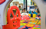 WATERBURY, CT-101317JS15-- Seiry Santiago, 2, of Waterbury, plays in the Children's Room at the Silas Bronson Library in Waterbury on Friday. Her mother said she loves bring her daughter to the library because there is so much to do. <br /> Jim Shannon Republican-American