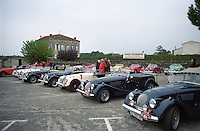 Morgan vintage car club parked in the lot. The town. Saint Emilion, Bordeaux, France