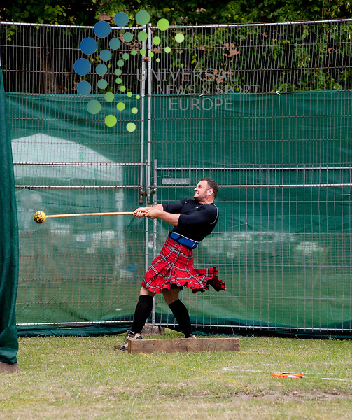 The first of what is expected to be a long line of Highland Games in the West end, took place today to celebrate the end of the West End Festival. The event featured traditional games, Highland Dancers and Pipe Band as well as less traditional funfair activities...Hughenden Rugby Club, Great Western Road, Glasgow , Scotland.  Picture: Euan Anderson/Universal News And Sport (Scotland) 26th June 2010.