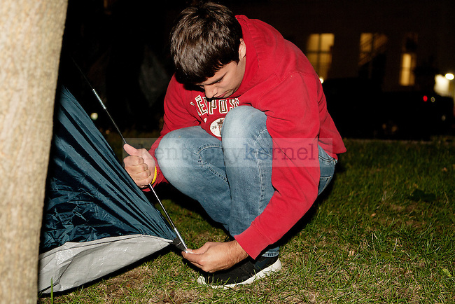A UK fan sets up his tent during Big Blue Madness campout in Lexington, Ky.,on Wednesday, September 17, 2014. Photo by Michael Reaves | Staff