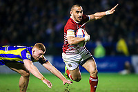 Picture by Alex Whitehead/SWpix.com - 09/03/2017 - Rugby League - Betfred Super League - Warrington Wolves v Wigan Warriors - Halliwell Jones Stadium, Warrington, England - Wigan's Thomas Leuluai escapes the tackle of Warrington's Jack Hughes.