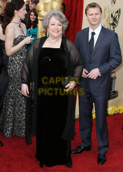 KATHY BATES.The 82nd Annual Academy Awards held aat The Kodak Theatre in Hollywood, California, USA..March 7th, 2010.oscars full length black maxi velvet dress sheer see thru through clutch bag wrap shawl .CAP/EAST.©Eastman/Capital Pictures.