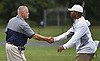 Baldwin varsity football head coach Steve Carroll, left, shakes hands with Oceanside head coach Rob Blount after their team's Nassau County Conference I game at Baldwin High School on Saturday, Oct. 6, 2018.
