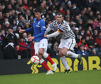 Emilson Cribari passes under pressure from Anthony Quinn in the Queen's Park v Rangers Irn-Bru Scottish League Division Three match played at Hampden Park, Glasgow on 29.12.12.