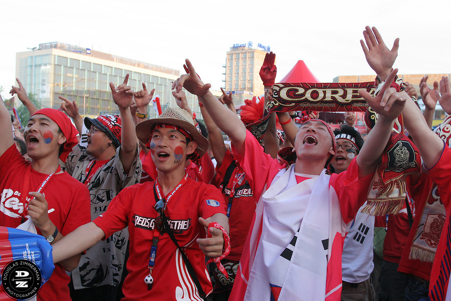 South Korean National Soccer Team fans cheer for their national team while watching the FIFA World Cup first round match against France at the Fan Festival in downtown Leipzig, Germany on Sunday, June 18th, 2006. The teams drew 1-1.
