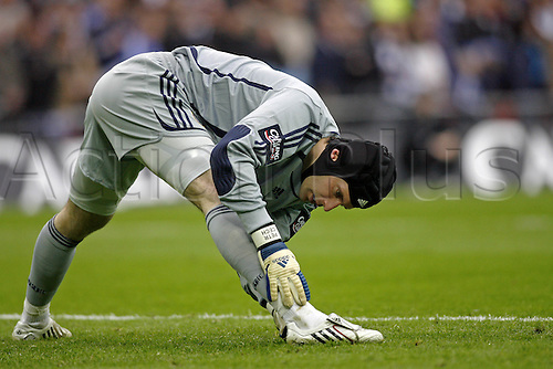 24 February 2008: Chelsea goalkeeper Petr Cech does stretching exercises at the start of the Carling Cup Final between Tottenham Hotspur and Chelsea, played at Wembley Stadium. Spurs won the game 2-1 after extra time. Photo: Actionplus....080224 football soccer player warming up keeper