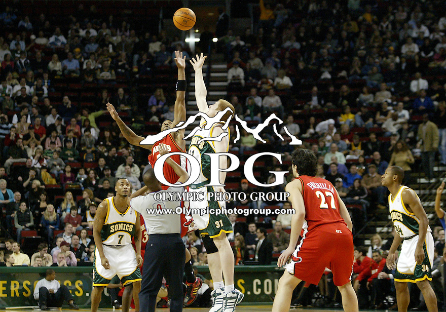 Seattle Super Sonics center Robert Swift #31 and Atlanta Hawks center #5 Josh Smith battle for the opening tip off during the game at Key Arena in Seattle, WA. ...