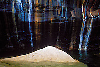 Sandstone cliffs are stained by mineral seeps in Pictured Rocks National Lakeshore near Munising, Mich.