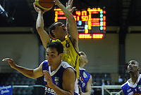 Taranaki guard Josh Paurini lays a shot up under pressure during the National basketball league match between the Wellington Saints  and Taranaki Mountainairs at TSB Bank Arena, Wellington, New Zealand onFriday, 9 April 2010. Photo: Dave Lintott / lintottphoto.co.nz