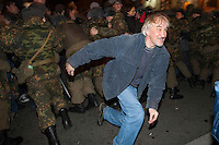 Moscow, Russia, 31/10/2010..A demonstrator breaks through a police and army security cordon at the first Strategy 31 anti-government demonstration to be permitted after all previous such demonstrations were broken up by police. Opposition activists hold regular demonstrations on the 31st day of the month, protesting against restrictions on the freedom of assembly, which is protected by article number 31 of the Russian constitution.