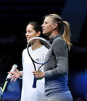 BOGOTA - COLOMBIA - 06-12-2013: Maria Sharapova, tenista de Rusia, y Ana Ivanovic, tenista de Serbia durante entreno antes de partido de exhibición.  / Maria Sharapova, Russian tennis player and Ana Ivanovic the Serbian tennis player, during a training session before the exhibition match. / Photo:  VizzorImage / Luis Ramirez / Staff.