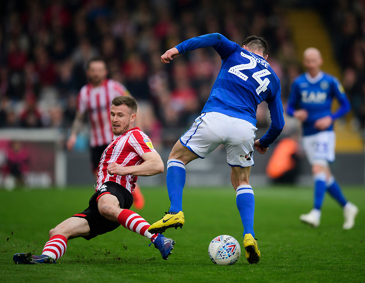 Lincoln City's Michael O'Connor vies for possession with Macclesfield Town's Michael Rose<br /> <br /> Photographer Chris Vaughan/CameraSport<br /> <br /> The EFL Sky Bet League Two - Lincoln City v Macclesfield Town - Saturday 30th March 2019 - Sincil Bank - Lincoln<br /> <br /> World Copyright © 2019 CameraSport. All rights reserved. 43 Linden Ave. Countesthorpe. Leicester. England. LE8 5PG - Tel: +44 (0) 116 277 4147 - admin@camerasport.com - www.camerasport.com