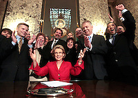 Governor Christine Gregoire, with members of the Washington State legislature, react to the crowd immediately after signing the gay-marriage bill into law on February 13, 2011. The historic law takes effect June 7th, though opponents have vowed to overturn it with a ballot measure. Left, standing, is Rep. Jamie Pedersen, and right, Sen. Ed Murray and his longtime partner Michael Shiosaki. Meryl Schenker Photography