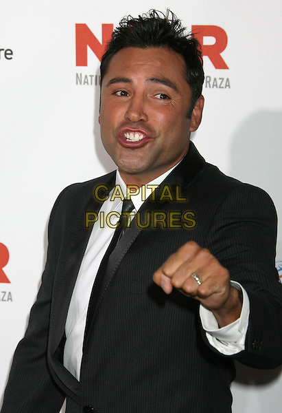 OSCAR DE LA HOYA.2009 ALMA Awards held at Royce Hall on the UCLA Campus, Westwood, CA, USA..September 17th, 2009.half length black suit jacket hand fist ring mouth open .CAP/ADM/MJ.©Michael Jade/AdMedia/Capital Pictures.