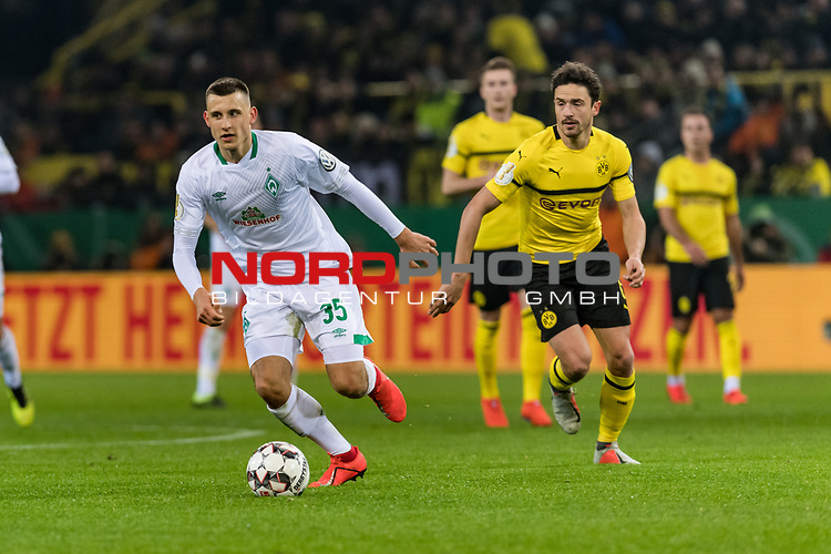 05.02.2019, Signal Iduna Park, Dortmund, GER, DFB-Pokal, Achtelfinale, Borussia Dortmund vs Werder Bremen<br /> <br /> DFB REGULATIONS PROHIBIT ANY USE OF PHOTOGRAPHS AS IMAGE SEQUENCES AND/OR QUASI-VIDEO.<br /> <br /> im Bild / picture shows<br /> Maximilian Eggestein (Werder Bremen #35), Thomas Delaney (Dortmund #06), <br /> <br /> Foto © nordphoto / Ewert