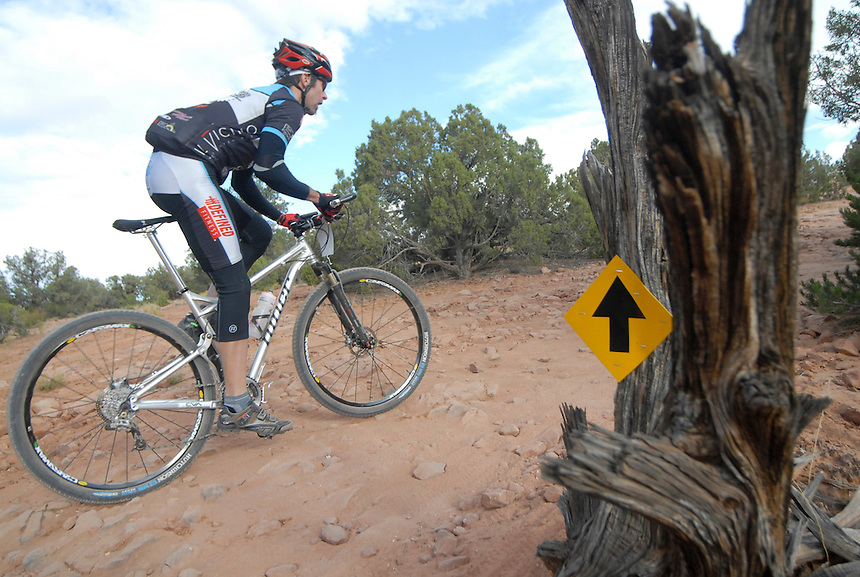 A mountain bike racer navigates the rocky course of the 24 hours of Moab.